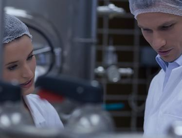 process industry male and female with hair nets